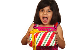 Gift. A little asian girl geting the Christmas gift stock photography