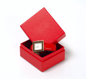 Gift. Red gift case with a luxury watch Royalty Free Stock Image