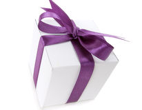 Gift. White box with purple ribbon on white background Royalty Free Stock Photo
