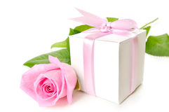 Gift. Pink rose with gift-box on white background Stock Images