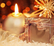 Gift. Winter holiday background with silver present gift box, candle ornament & Christmas snow decoration stock photography