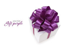 Gift. White box with purple ribbon on white background. Copyspace Stock Photos
