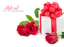 Gift. Red roses with gift-box on white background Stock Image