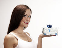 The Gift Beautiful Brunette Woman offers Gift royalty free stock image