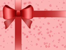 Gift. Present  with red bow,  red hearts and pink background Royalty Free Stock Photos