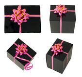 Gift. Four black gift tied with a pink ribbon and bow Royalty Free Stock Photography