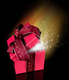 Gift. Celebration theme with red gift and shiny aura on background Stock Photography