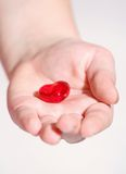 Gift. Hand of children giving heart Royalty Free Stock Photos