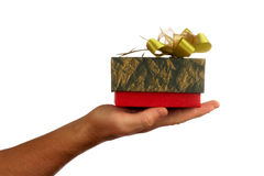 A gift. View of human's hand  and nice colorful box with present on it Stock Image