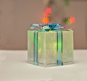 The Gift. Christmas Present with Holiday Background Stock Image