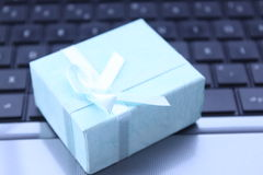 Gift on the laptop Stock Image
