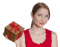 Gift. Beautiful young woman is holding a gift Stock Photography