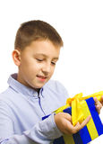 Gift. Boy holding a gift in his hands smiling Royalty Free Stock Image