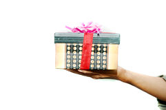 A gift. Hand holding a gift isolated on white background Stock Images