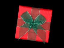 Gift. Top of red gift with green ribbon - black background royalty free stock image