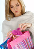 Gift. Happy young woman with bags Royalty Free Stock Photos