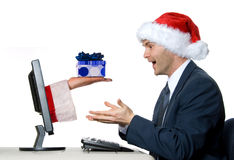 The Gift. Man receiving a x-mas gift by internet via santa royalty free stock photography