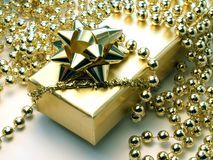 Gift. In golden box Stock Images
