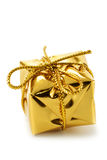 Gift. Golden box isolated over a white background Stock Photography