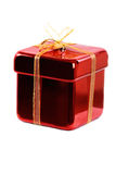 Gift. A gift wrapped in yellow and red on a white background royalty free stock image