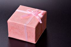 Gift. Pink gift box with ribbon Royalty Free Stock Photography