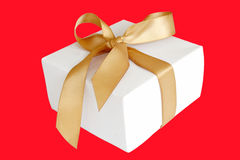 Gift. White gift isolated on red Stock Image
