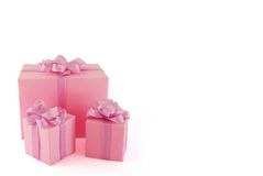 Gift. Few pink boxes on the white background royalty free stock images