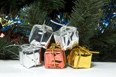 Gift. The packed gifts under a fur-tree Royalty Free Stock Images