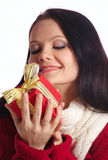 Gift. Girl with a gift on a white background royalty free stock images