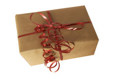 Gift. A nicely wrapped gift with a red ribbon royalty free stock images