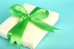 Gift. Pretty gift with green bow; fresh colors royalty free stock photo