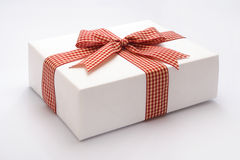 Gift. Against white background Stock Images