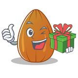 With gift almond nut character cartoon Stock Photo