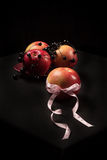Gift apple. Beautiful apple tied with a ribbon with hearts Stock Image