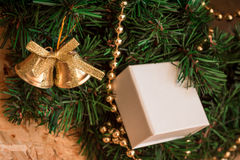 Gift, artificial Christmas wreath, decorations. Royalty Free Stock Photography