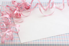 Gift for baby girl. Curly pink ribbons on a gift for a Girl's baby shower Royalty Free Stock Photo
