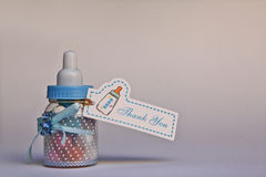 Gift for baby shower. Bottle with sweets as a gift for a baby shower Stock Images