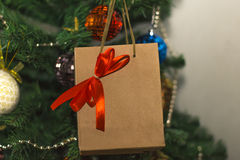 Gift on the background of Christmas toys. On a tree Stock Photo