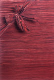 Gift Background Texture - Vertical. Vertical crimson red fabric textured gift background with a ribbon and box in the upper left corner running diagonally Stock Images