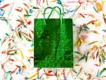 Gift bag. Green gift bag on the confetti. Shallow dof Stock Image