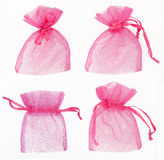 Gift bag. Small transparent gift bag in pink color on white background Royalty Free Stock Photos