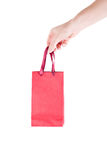 Gift bag. Hand and gift bag on white background Royalty Free Stock Images