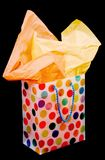 Gift Bag. A multi-color gift bag isolated on black Royalty Free Stock Photo