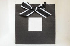 Gift bag. Black gift bag with ribbon Stock Image