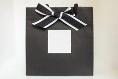 Gift bag. Black gift bag with ribbon stock image