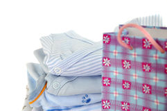 Gift Bag and Blue Baby Clothes Royalty Free Stock Photo