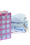 Gift Bag and Blue Baby Clothes Royalty Free Stock Photography