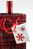 Gift bag with bottle Royalty Free Stock Photos