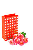 Gift bag and a bouquet of roses. Royalty Free Stock Image