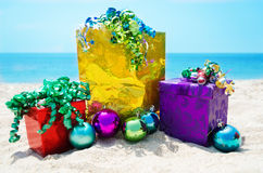 Gift bag and boxes with Christmas balls - holiday concept Stock Photos